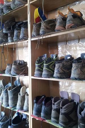 Boots on shelves along the Camino de Santiago