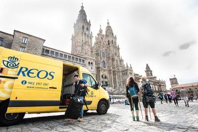Correos bag transport van in Santiago and pilgrims waiting for their bags.